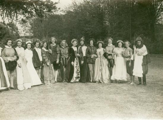 Sepia toned image of the cast in 1948