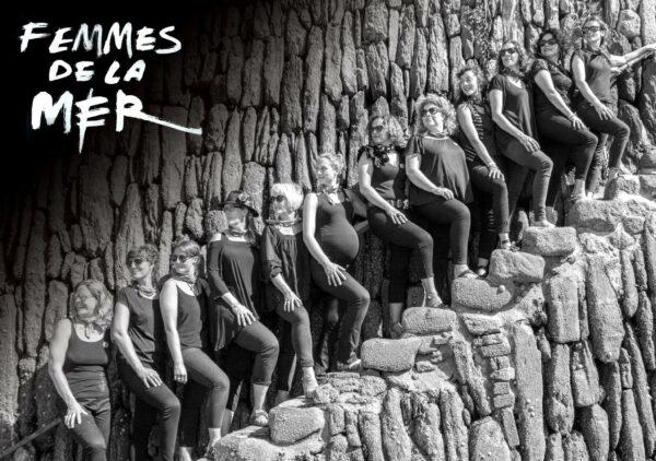 Femmes de la mer lined up on steps