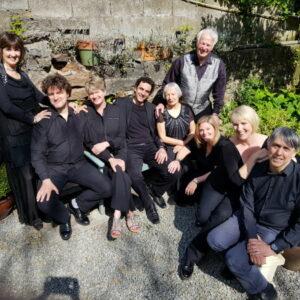 Ensemble sitting in a sunlit garden