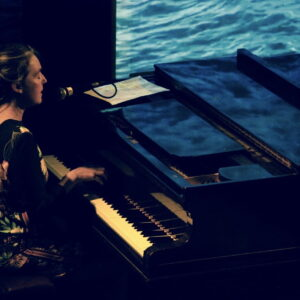 Kelsey singing and playing piano