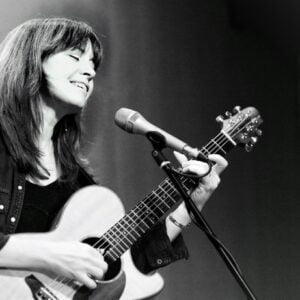 Sarah performing with her guitar