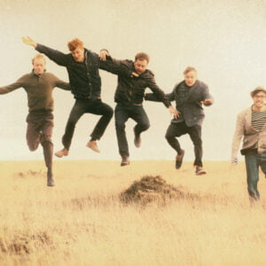 The Oddfolk jumping in the air