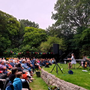 Students performing to a large audience